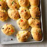 A pan of just-baked stollen butter rolls