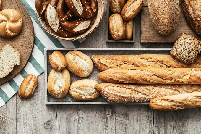 Freshly baked delicious bread on a rustic wooden worktop