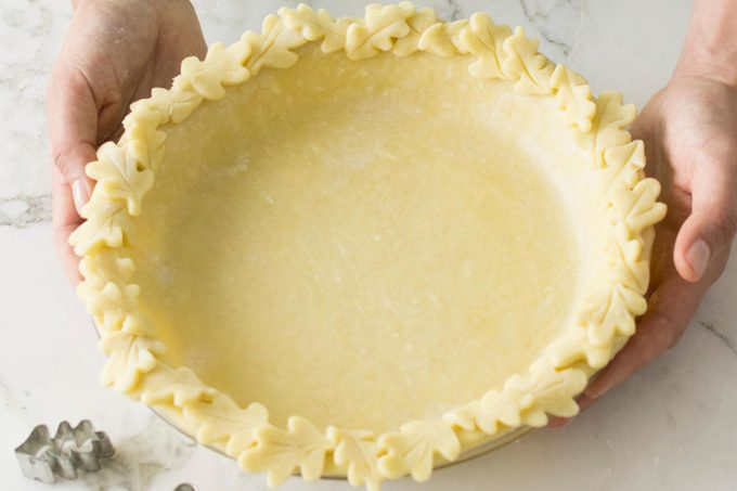Method for how to decorate pie crust. Image of leaf crust trim.