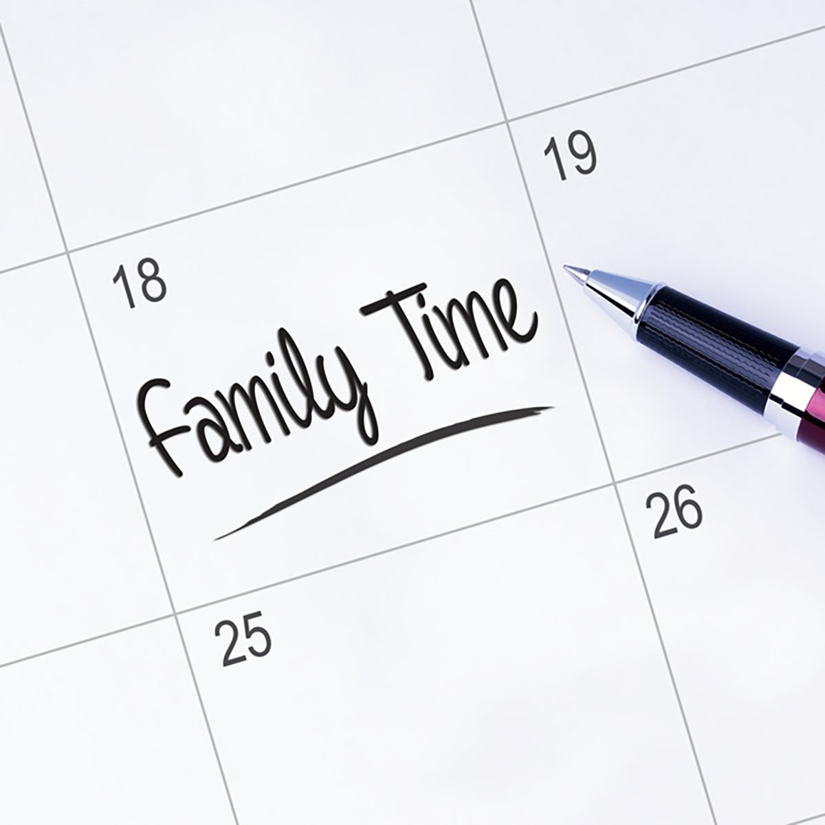 The words Family Time written on a calendar planner to remind you an important appointment with a pen on isolated white background.