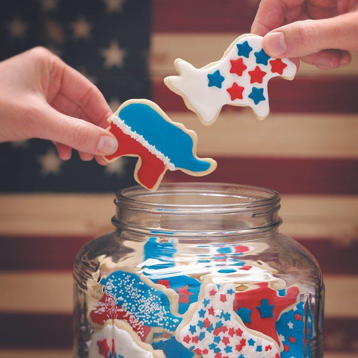 hands grabbing election day cookies in a patriotic scene