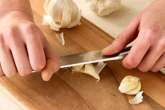 smashing garlic with a knife