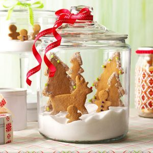 Gingerbread reindeer and trees in a glass jar with sugar snow