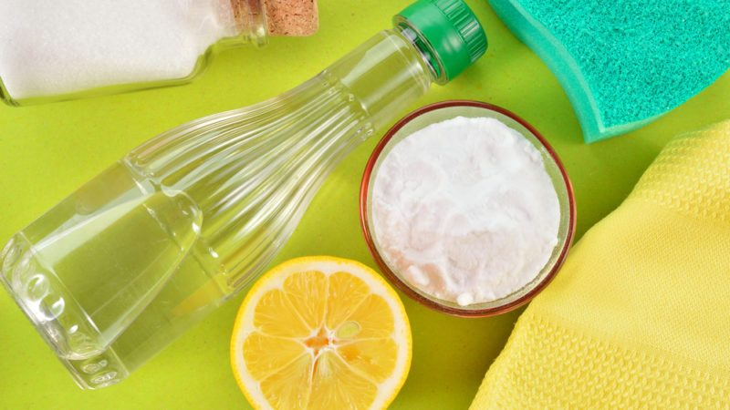 Eco-friendly natural cleaners. Vinegar, baking soda, salt, lemon and cloth