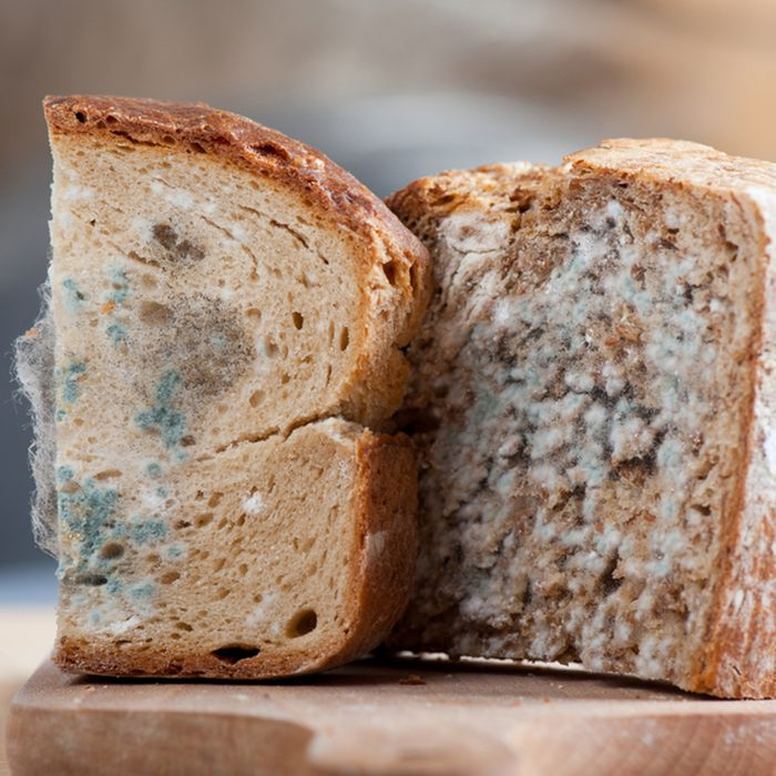 Two moldy bread portions, slices of food with toxic mold or mould with plenty colored spores lying on wooden board with blurred background. Nobody, horizontal orientation.; Shutterstock ID 159728873; Job (TFH, TOH, RD, BNB, CWM, CM): TOH