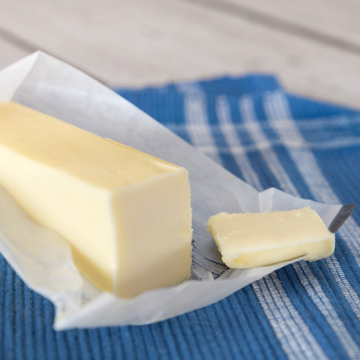Stick of creamery butter in opened wrapper; Shutterstock ID 368432732; Job (TFH, TOH, RD, BNB, CWM, CM): Taste of Home