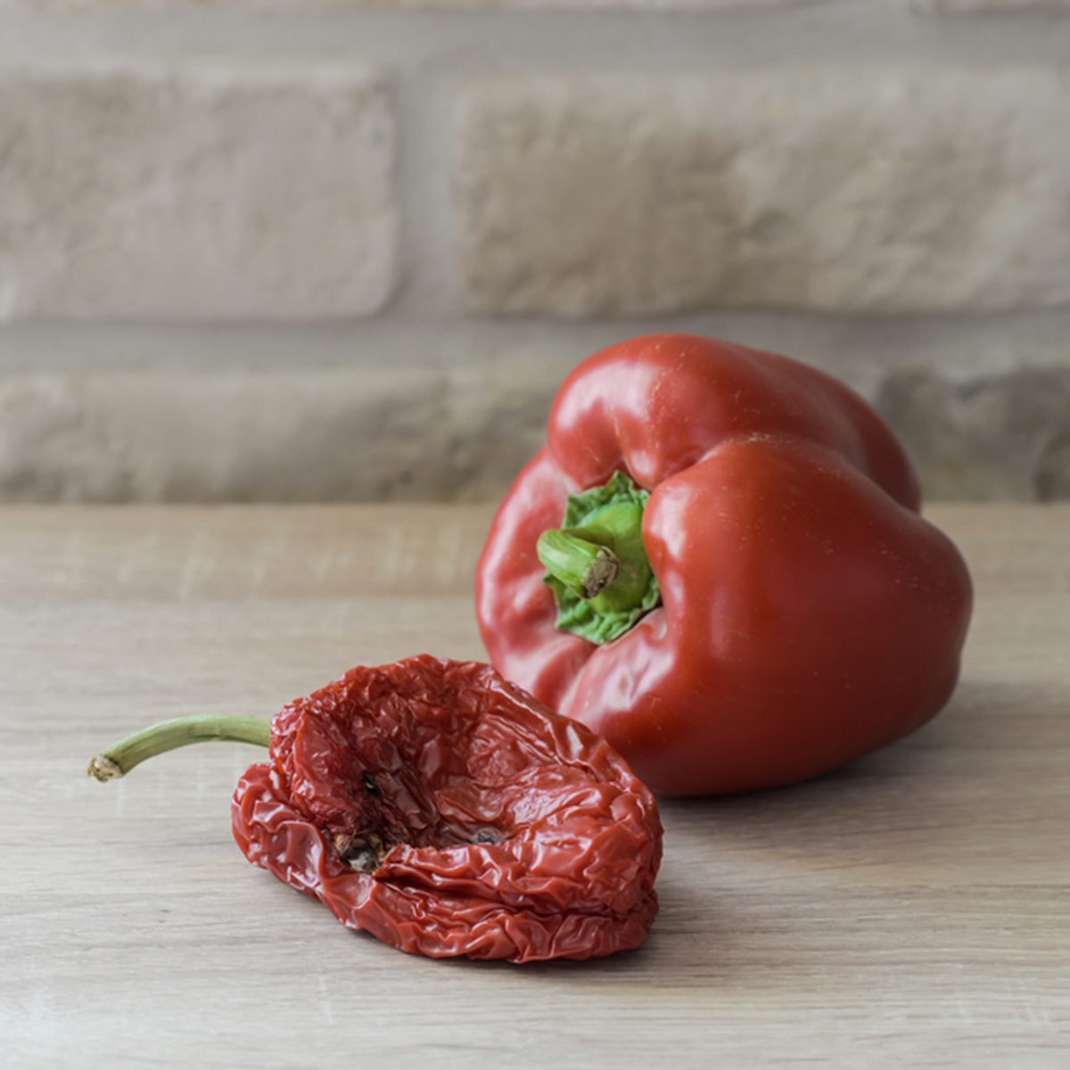 Wilted or fresh sweet pepper on a wooden table. Unhealthy or healthy food; Shutterstock ID 369647651; Job (TFH, TOH, RD, BNB, CWM, CM): TOH
