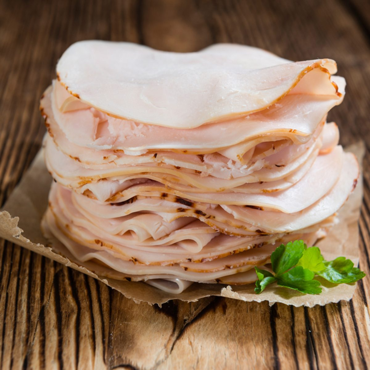 Sliced Chicken Breast fillet (selective focus) on wooden background; Shutterstock ID 381413266; Job (TFH, TOH, RD, BNB, CWM, CM): TOH