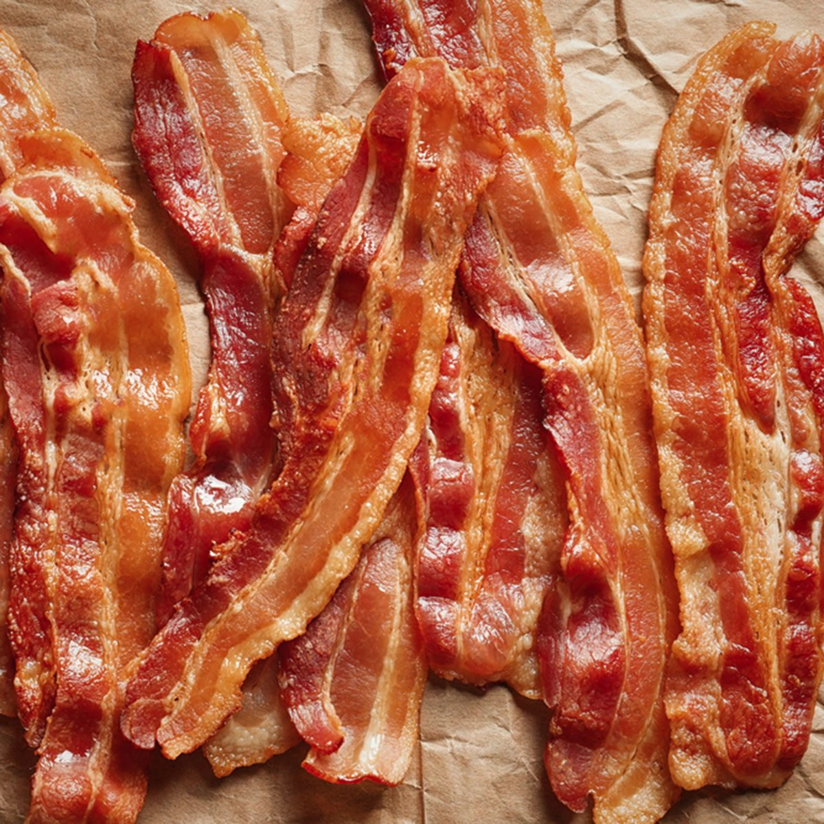 Cooked bacon rashers on parchment; Shutterstock ID 758704648