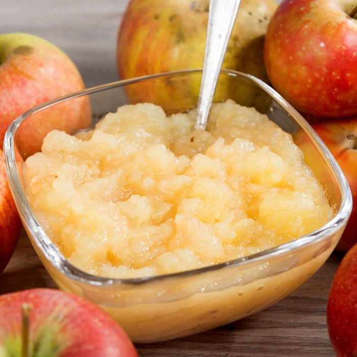 an applesauce with apples on a wooden table; Shutterstock ID 761557831; Job (TFH, TOH, RD, BNB, CWM, CM): Taste of Home