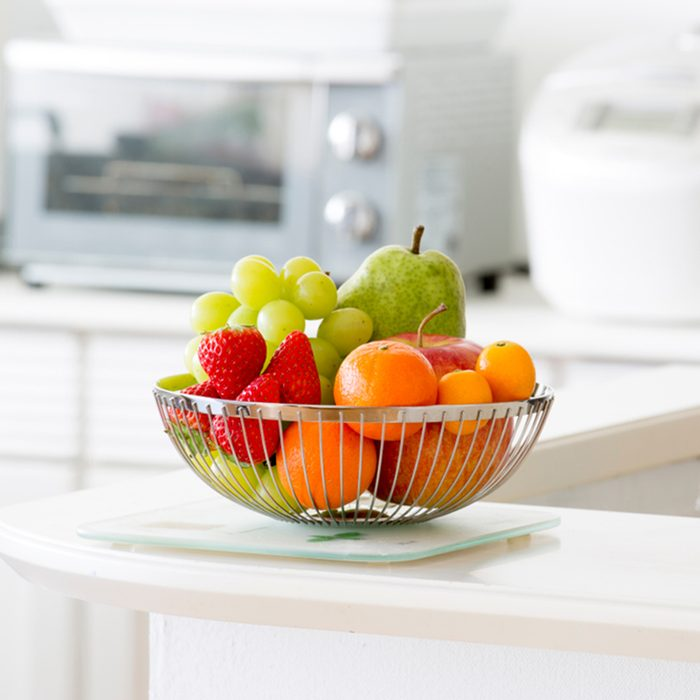 Fruit basket in bright kitchen; Shutterstock ID 1047379687; Job (TFH, TOH, RD, BNB, CWM, CM): TOH