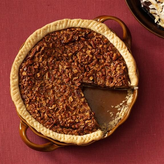 Birds-eye view of a pecan pie on a red tablecloth