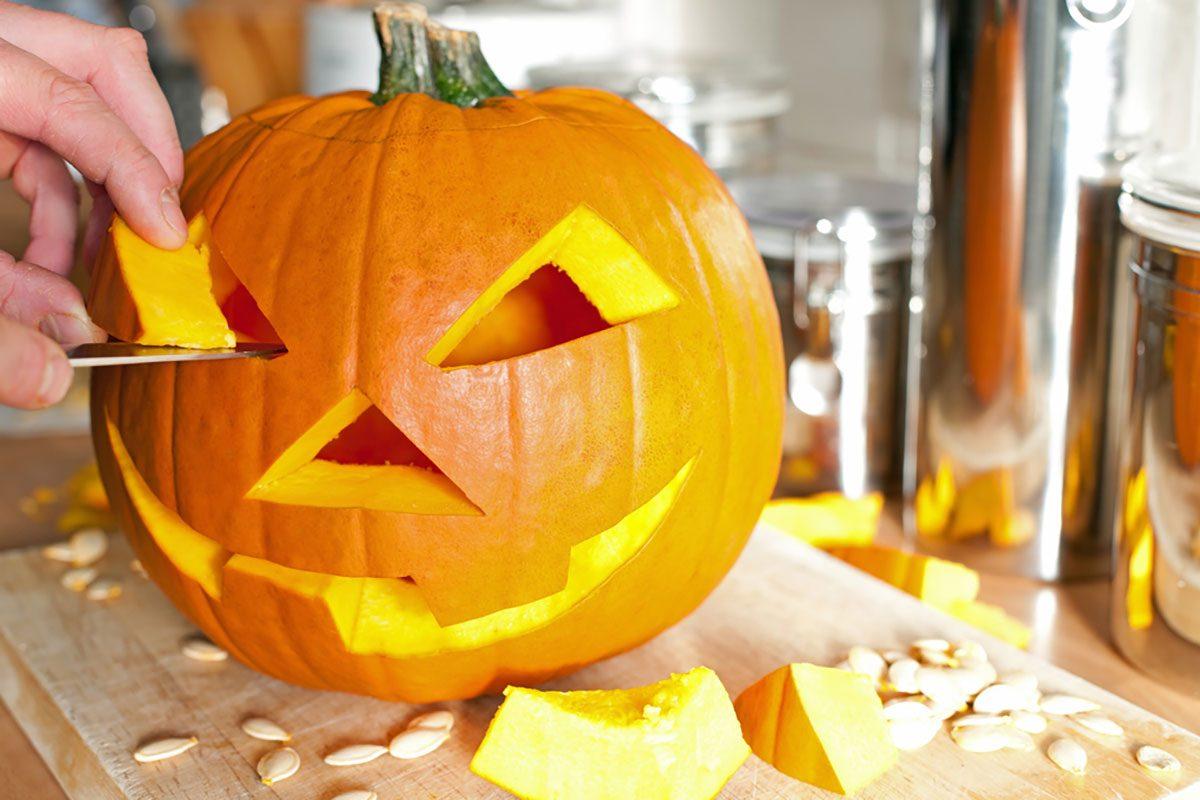 Halloween pumpkin Jack O'Lantern being carved for Halloween