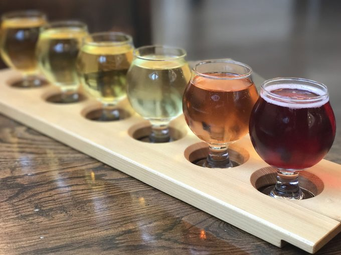 Cider tasting flight on a wood board