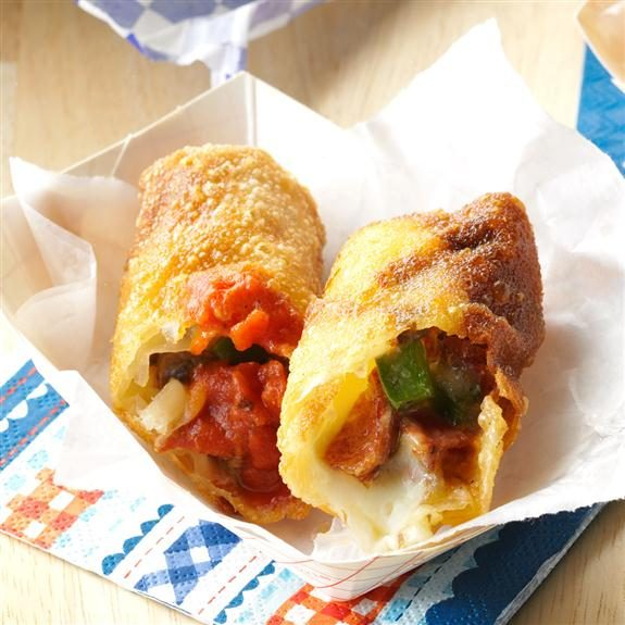 Pepperoni pizza roll split in half on a napkin in a paper dish