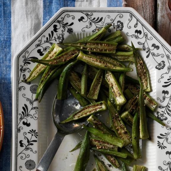 Roasted Fresh Okra in a white dish decorated with navy-color floral designs
