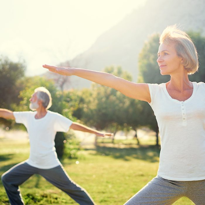 Yoga at park. Senior family couple exercising outdoors. Concept of healthy lifestyle.; Shutterstock ID 581710294; Job (TFH, TOH, RD, BNB, CWM, CM): TOH