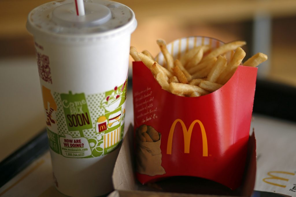 A large order of French Fries and drink are photographed at a McDonald's restaurant