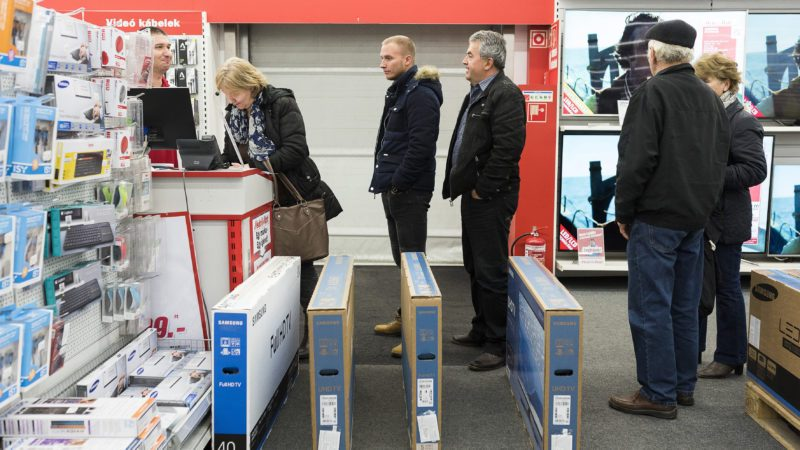 Customers Buying Television Sets Stand in Line at an Electronics Store During the Black Friday Shopping Event