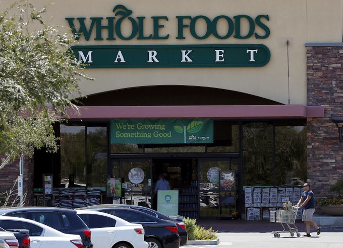 Shoppers come and go from Whole Foods Market grocery store