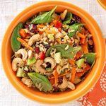 An orange bowl filled with Brown Rice Chutney Salad