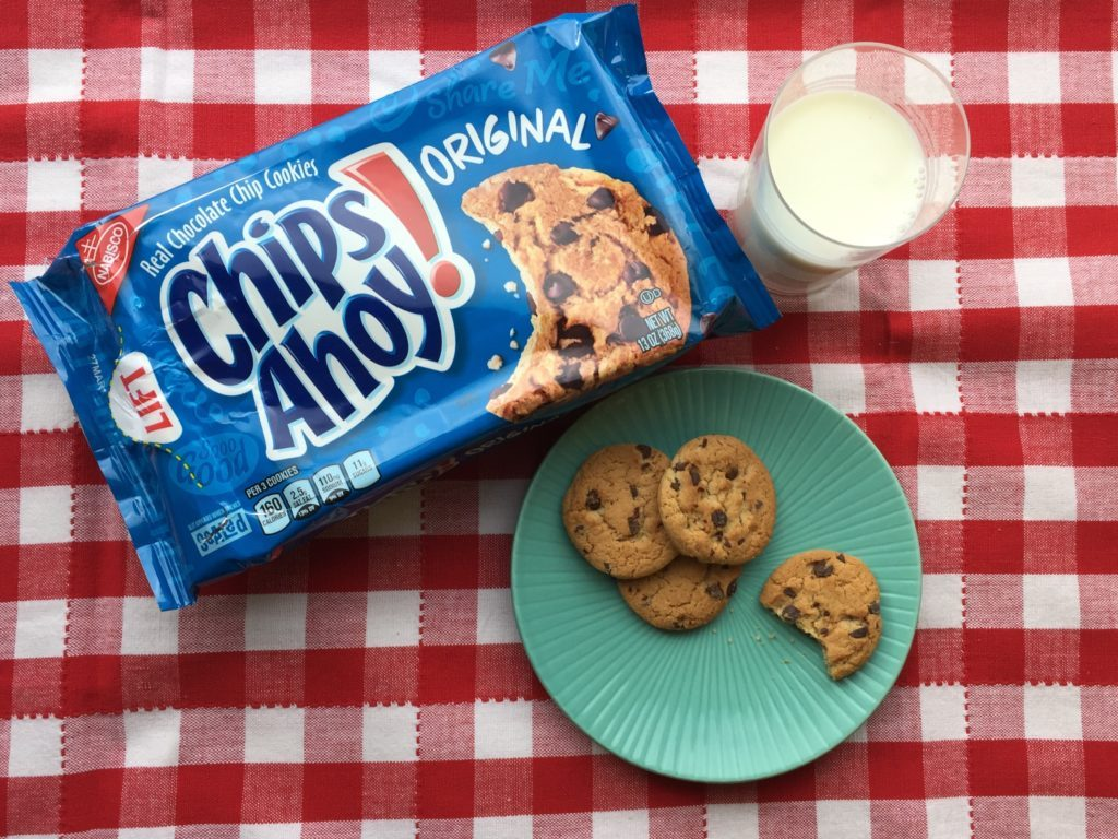 Package of Chips Ahoy! chocolate chip cookies beside a glass of milk and plate of cookies