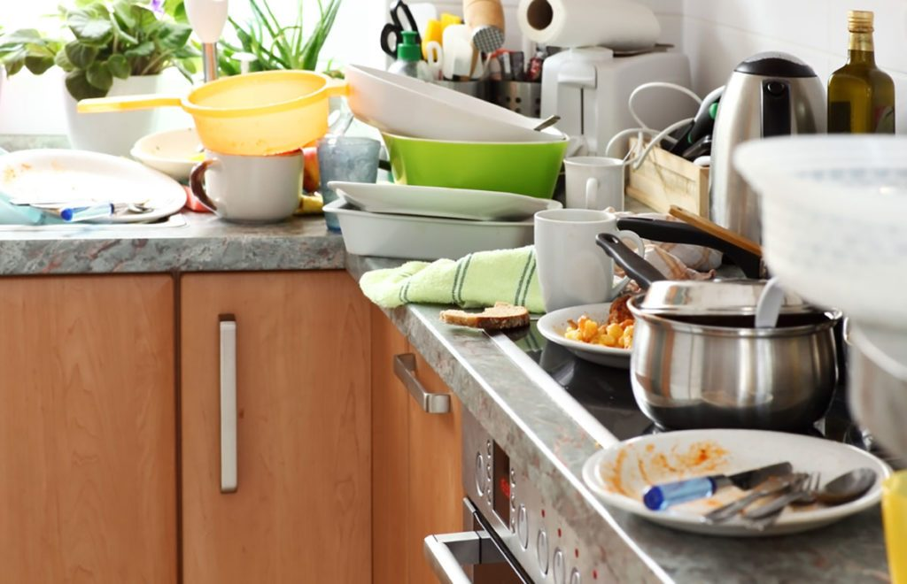 Pile of dirty dishes in the kitchen