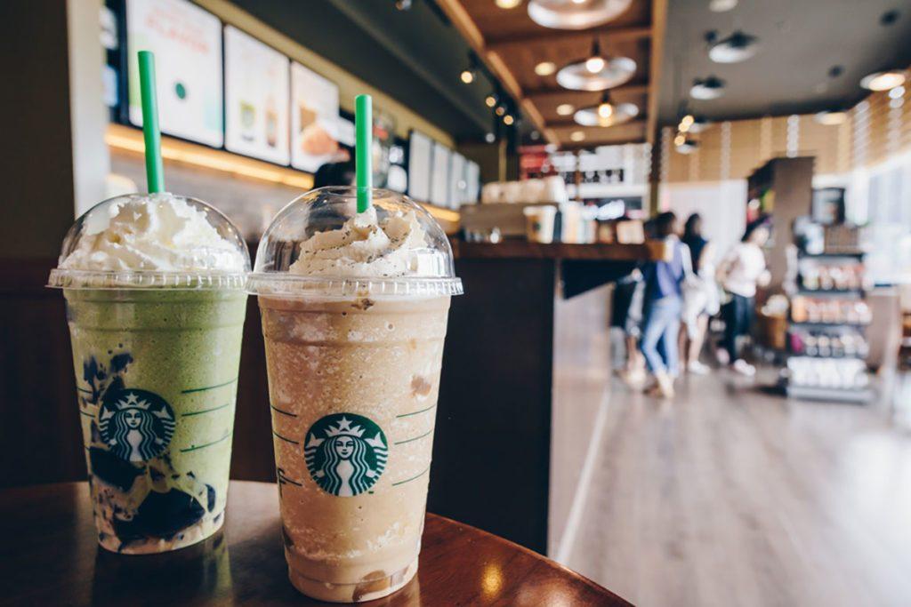 A Venti Starbucks frappuccino Irish coffee and Green tea latte frappuccino in Starbucks coffee shop.
