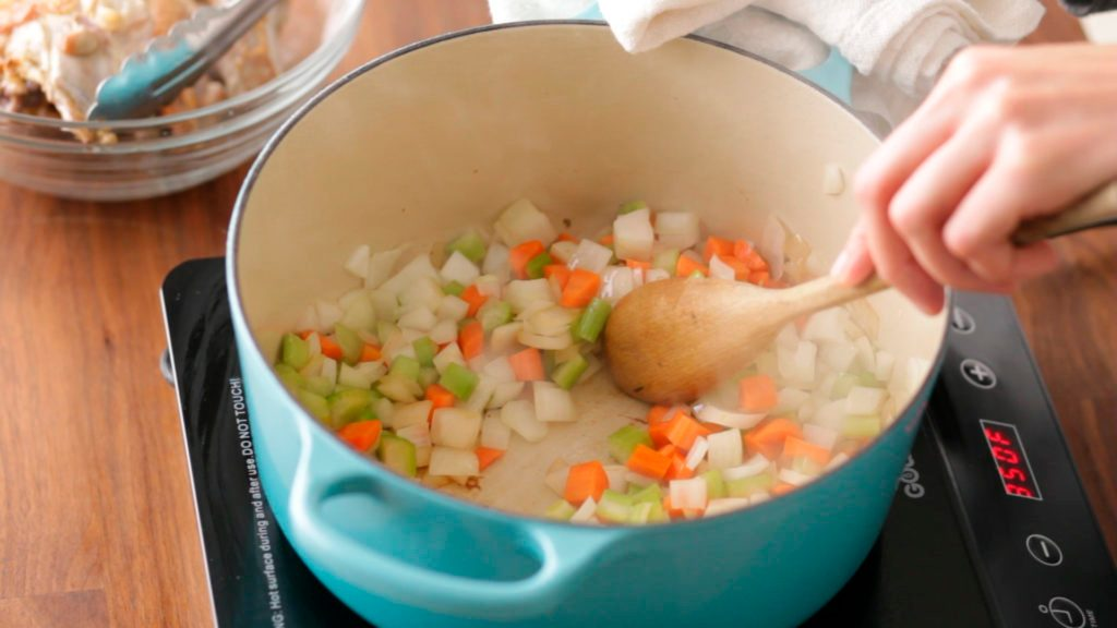 Diced vegetables in a stockpot