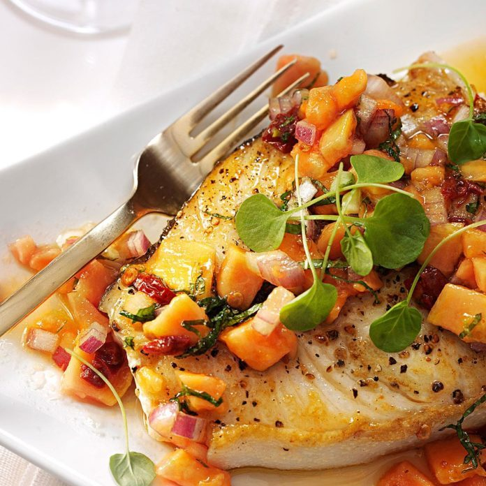 A plate with Halibut Steaks with Papaya-Mint Salsa.