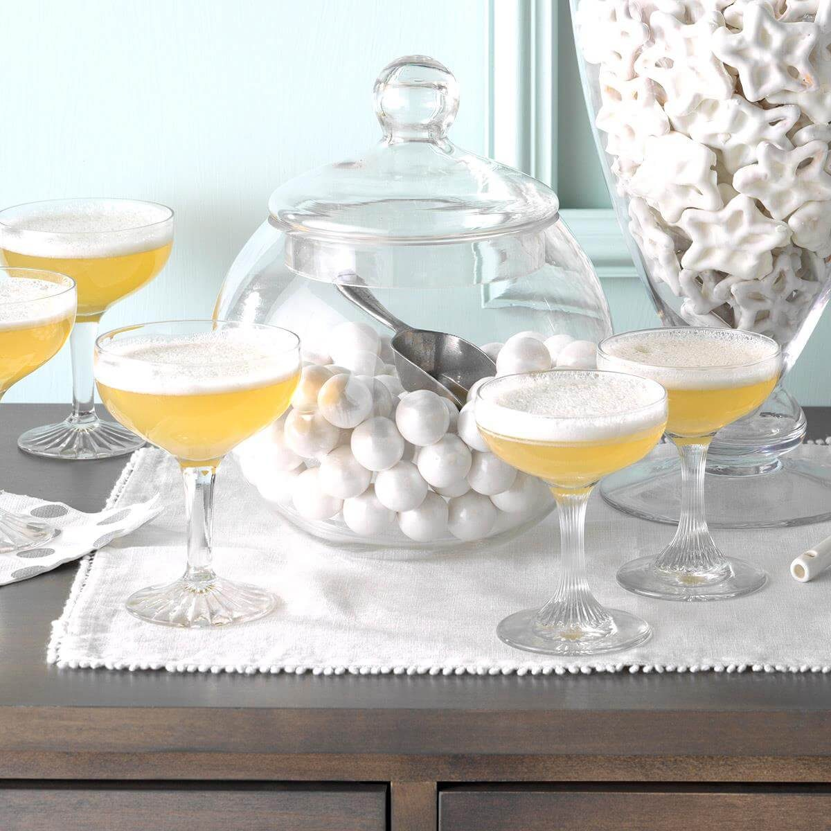 Champagne glasses with Jellied Champagne Dessert on a side table.
