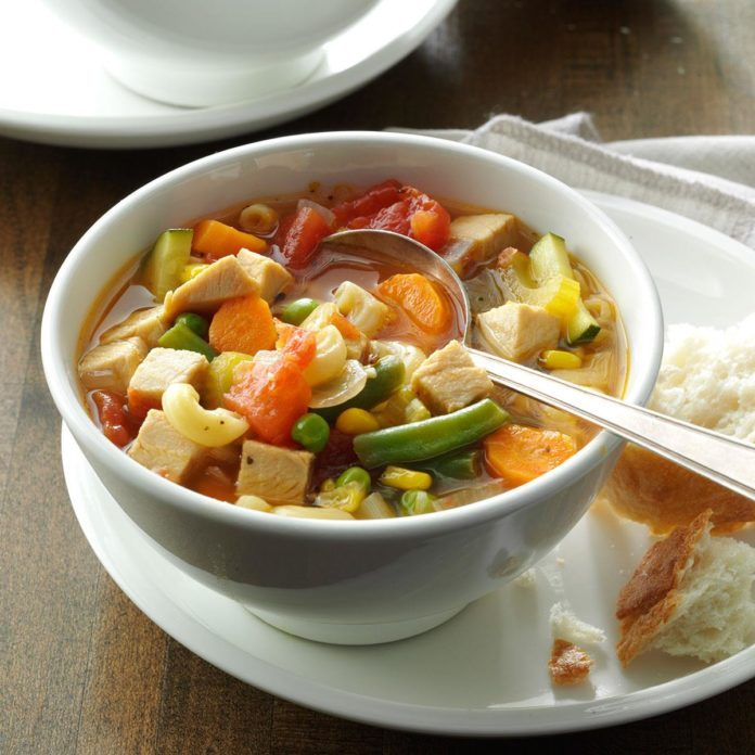 A bowl of minestrone with turkey soup.
