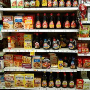 Grocery store shelf of maple syrups