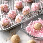 A tray filled with Raspberry Coconut Balls