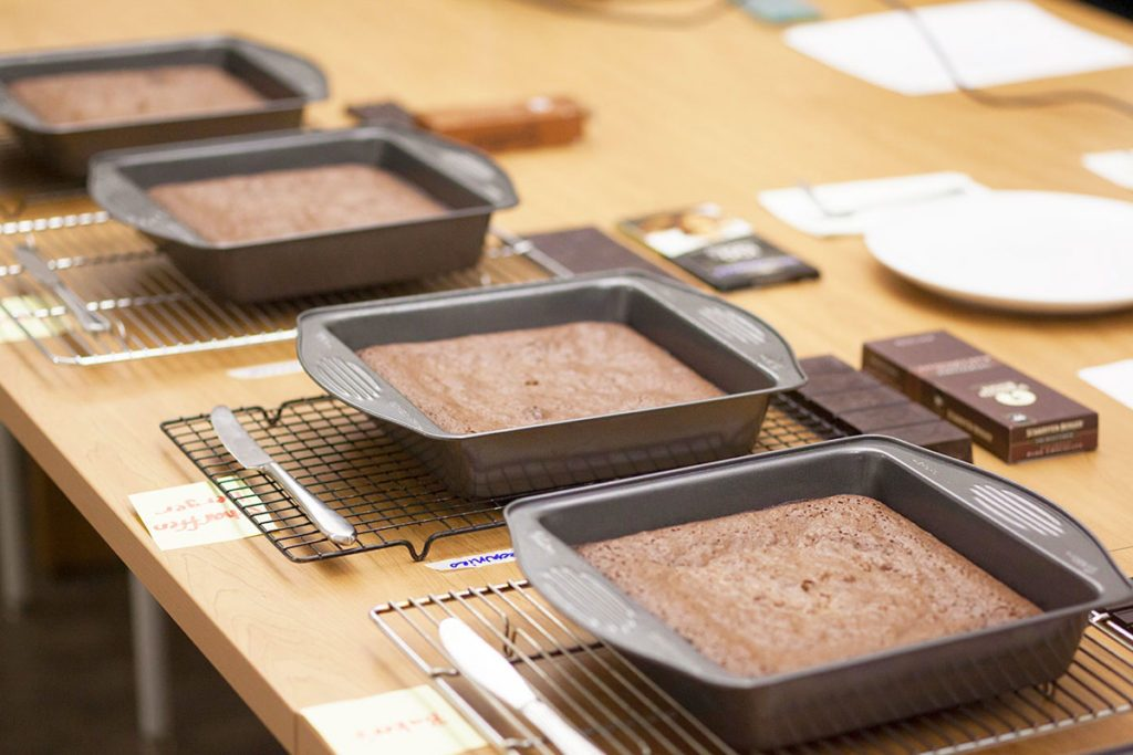 Line up of brownies in their pans