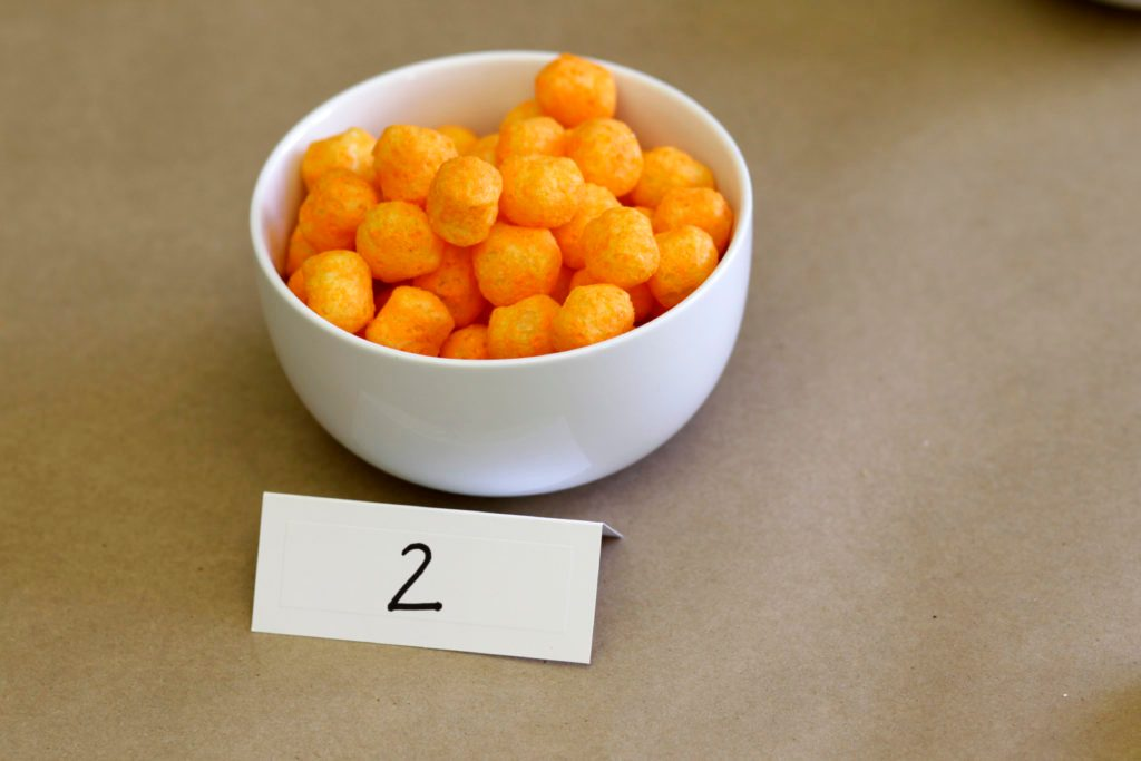 Bowl with the number 2 filled with cheese puffs