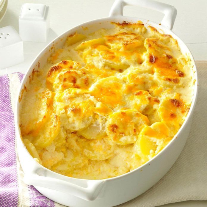 A casserole containing Sharp Cheddar Scalloped Potatoes