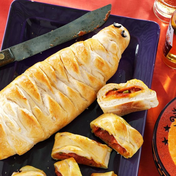 58 howling good halloween potluck recipes taste of home yummy mummy calzones forumfinder Choice Image