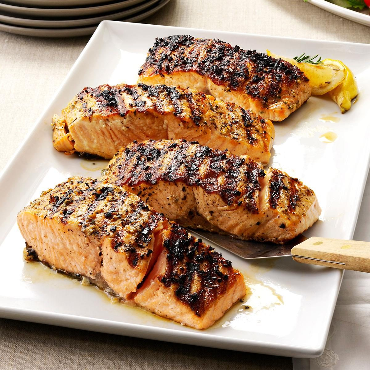 Grilled salmon on a plate with lemon.