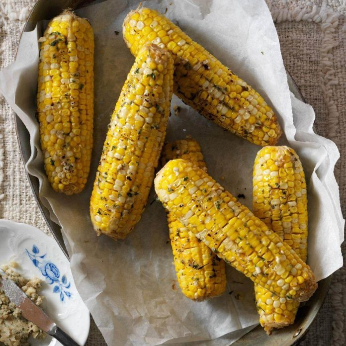 A pan with buttery horseradish corn on the cob