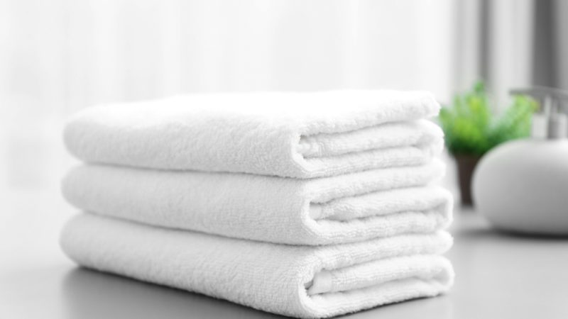 Stack of white clean towels on table in bathroom; Shutterstock ID 784953040; Job (TFH, TOH, RD, BNB, CWM, CM): TOH Fluffy towels