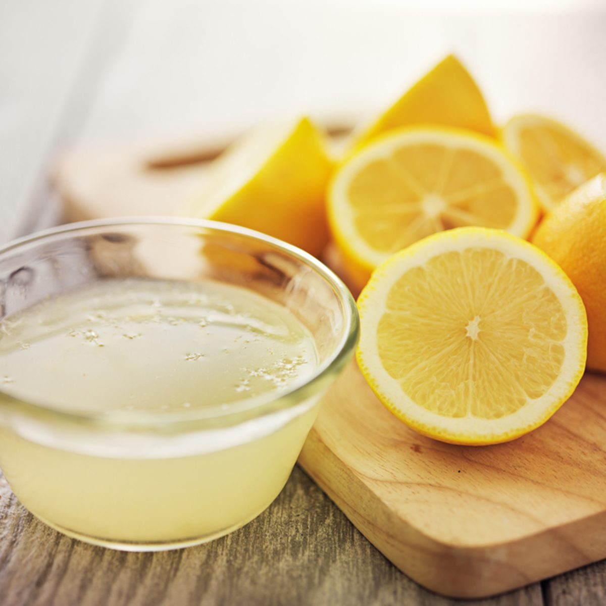 freshly squeezed lemon juice in small bowl; Shutterstock ID 211542739