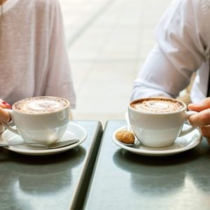 A man and woman with a cappuccino