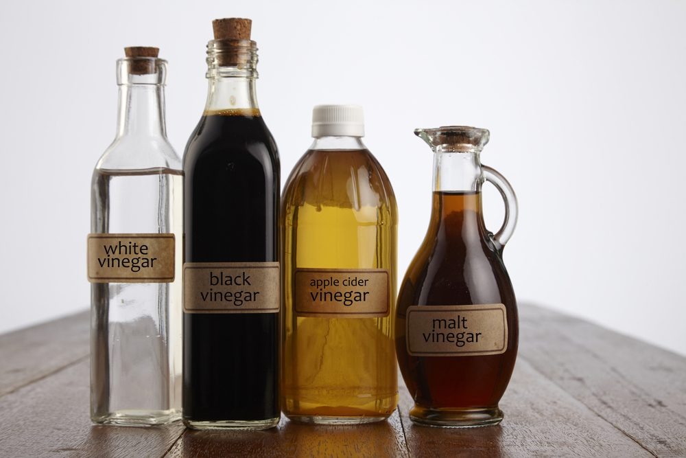 various vinegar on the wooden table top