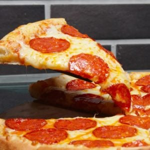 Slice of pizza pepperoni on scapula