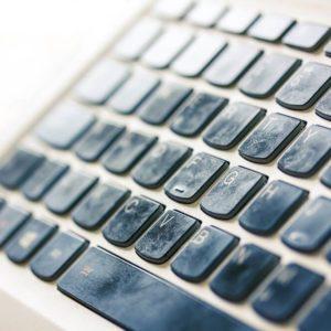 Greasy fingerprints on a computer keyboard close up