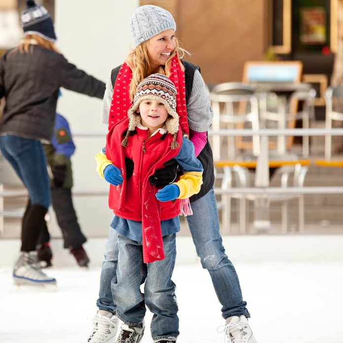 a mother helps her son learn to ice-skate; Shutterstock ID 67763563; Job (TFH, TOH, RD, BNB, CWM, CM): TOH
