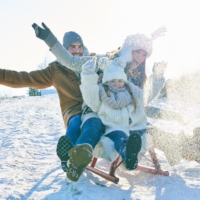 Family driving sled on the snow and having fun in winter; Shutterstock ID 725886205; Job (TFH, TOH, RD, BNB, CWM, CM): TOH