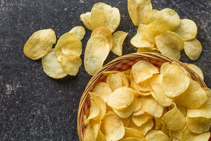 Potato chips in an over-filled bowl