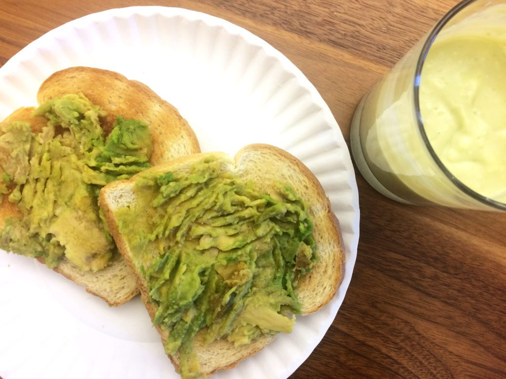Frozen avocado spread onto two slices of toast